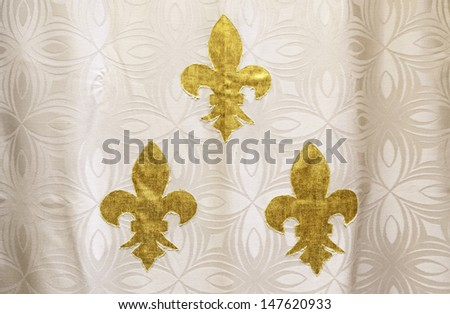 Lily flower fabric, detail of a city textile decoration, gold - stock photo