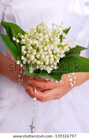 lily of the valley bunch for the first holy communion - stock photo