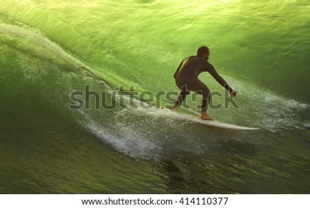 LIMA, PERU - CIRCA 2016: An unidentified man surfs a wave in La Herradura beach circa 2016, in Lima, Peru. - stock photo