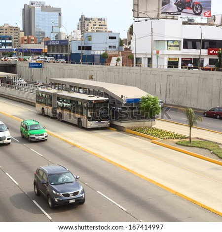 LIMA, PERU - FEBRUARY 13, 2012: Metropolitano bus of the Line B stopping at the Avenue Ricardo Palma in Miraflores on February 13, 2012 in Lima, Peru. The Metropolitano is a Bus rapid transit system. - stock photo