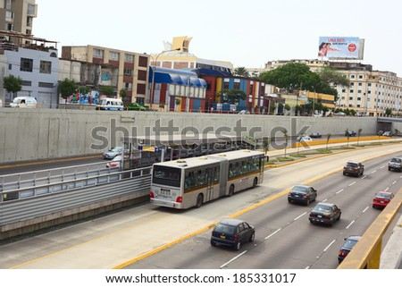 LIMA, PERU - FEBRUARY 13, 2012: Metropolitano bus stop at Ricardo Palma Avenue in Miraflores on February 13, 2012 in Lima, Peru. The Metropolitano is a Bus rapid transit system operating since 2010. - stock photo