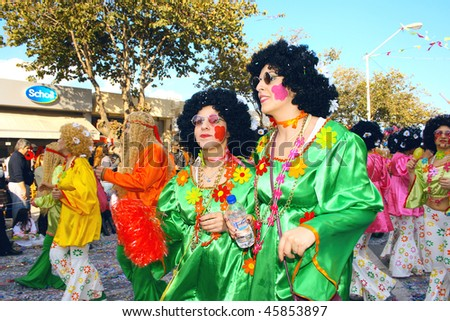 LIMASSOL, CYPRUS-MARCH 1: People parade during Cyprus annual carnival parade March 1, 2009 in Limassol, Cyprus. The carnival is celebrated with endless line of colorful extravagant floats and people - stock photo