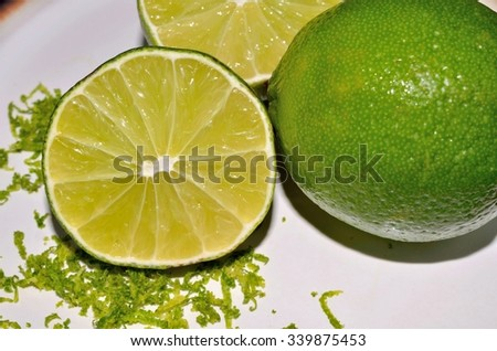Lime citrus fruit with aromatic zest - stock photo