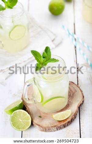 Lime, cucumber, mint lemonade, cocktail, fizz on a white wooden background - stock photo