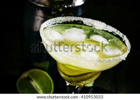 Lime Daiquiri in a glass decorated with sugar, black background, selective focus - stock photo