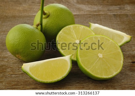 lime fruit on wooden background - stock photo