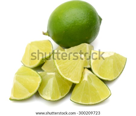 lime fruit with chopped lime fruit isolated on white background - stock photo