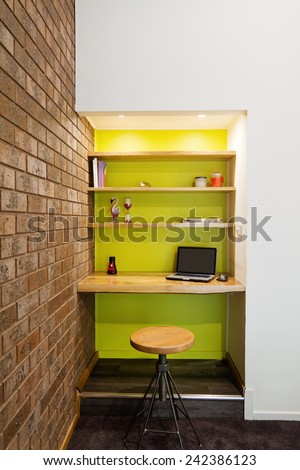 Lime green feature wall study nook in contemporary living room - stock photo