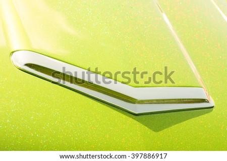 lime green glitter covered retro vehicle hood - stock photo