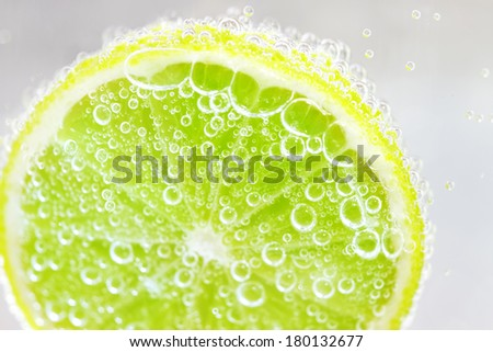 Lime in water on a light background - stock photo