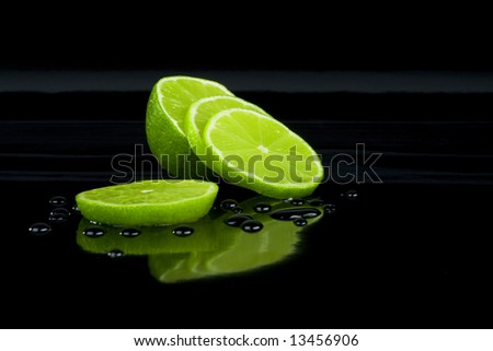 Lime on black and drops - stock photo