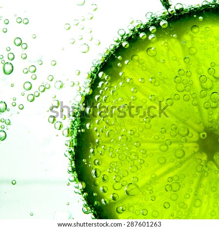 Lime Slice in Clear Fizzy Water Bubble - stock photo