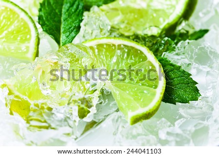 lime slices with ice and peppermint leaves  - stock photo