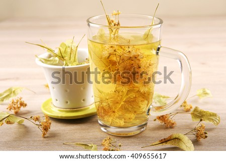 Lime tea. Glass cup of tea with herbal linden.  - stock photo