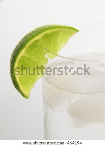 lime wedge on chilled glass of gin and tonic - stock photo