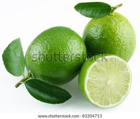 Lime with leaves on white background. - stock photo