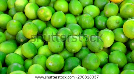Limes for sale at outdoor market - stock photo