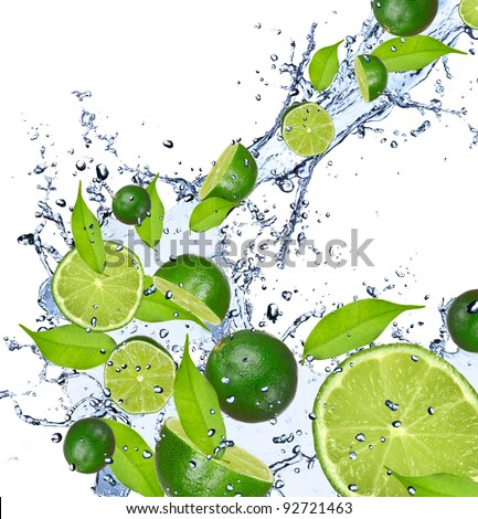 Limes pieces falling in water splash, isolated on white background - stock photo