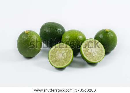 Limes whole and slices. Isolated on white - stock photo