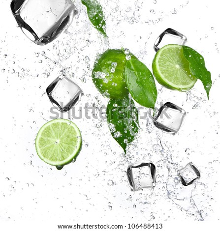 Limes with water splash and ice cubes - stock photo