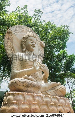 Limestone Buddhist statue - stock photo
