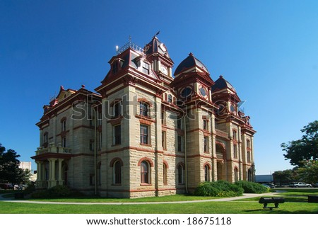 Limestone constructed county courthouse on the square. - stock photo