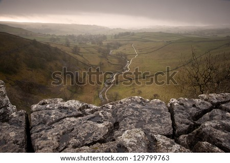 Limestone pavement overlooking Malham Beck and Dale in Yorkshire Dales National Park - stock photo