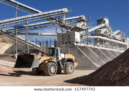 Limestone quarry with modern crushing and screening equipment  - stock photo
