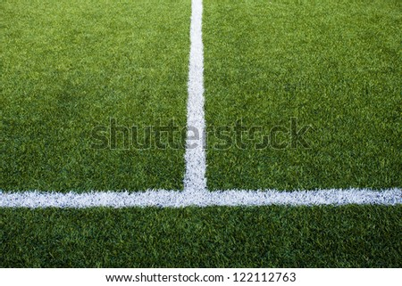 Limit lines of a sports grass field - stock photo
