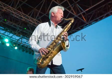 LINCOLN, CA - July 31: Johnny Colla with The News performs with Huey Lewis at Thunder Valley Casino Resort in in Lincoln, California on July 31, 2015 - stock photo