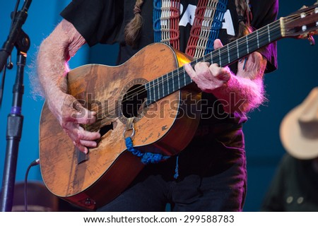 LINCOLN, CA - June 17: Willie Nelson plays his guitar, Trigger at Thunder Valley Casino Resort in in Lincoln, California on June 17, 2015 - stock photo