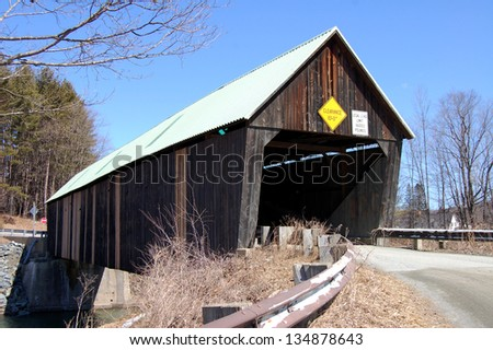 Lincoln Covered Bridge, in West Woodstock, Vermont. spans the Ottauquechee River. The truss bridge was built in 1877 and is 136 feet long. - stock photo