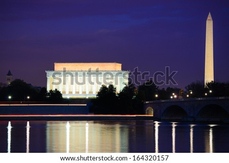 Lincoln Memorial and Washington Monument at night. A night view from riverside of the Potomac River - Washington DC, United States - stock photo