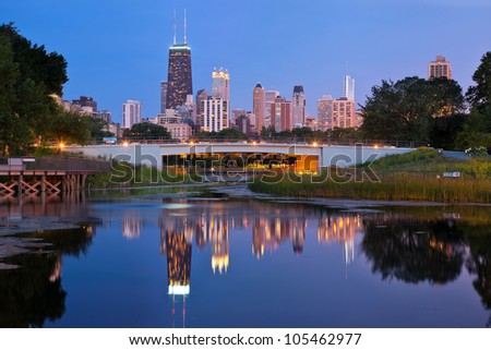 Lincoln Park, Chicago. Image of the Chicago downtown skyline at dusk. Lincoln Park in the foreground. - stock photo