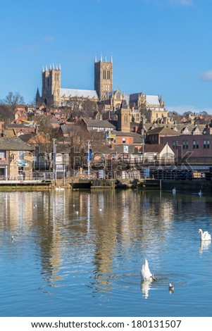 LINCOLN, UK - MARCH 03: A cityscape view of Lincoln with the cathedral in the background in Lincoln on 3rd of March 2014. - stock photo