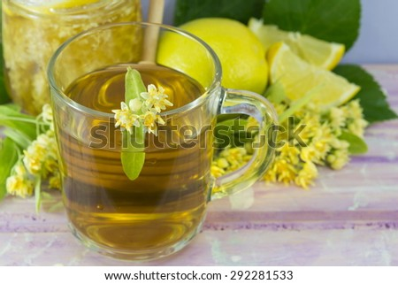 Linden tea with lemon decorated with lime flower served with honeycomb - stock photo