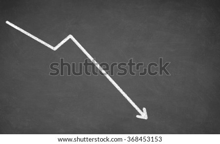 Line graph showing a downward trend. White chalk on blackboard - stock photo