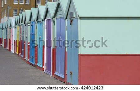 Line of Beach Huts in Brighton and Hove - stock photo
