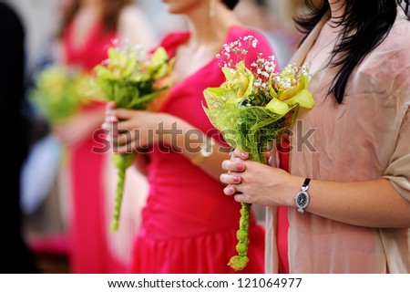 Line of bridesmaids' bouquets - stock photo