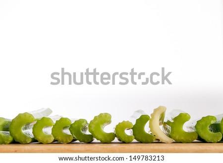 Line of C shaped celery stalks - stock photo