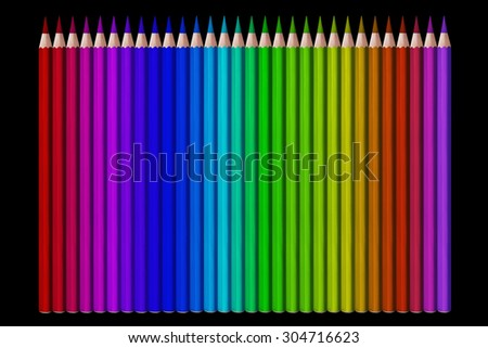 line of colored pencils on black background - stock photo