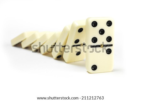 Line of Dominoe on white - stock photo