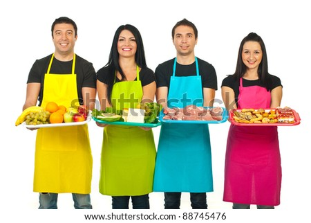 Line of four market workers  holding their products on plateaus isolated on white background - stock photo