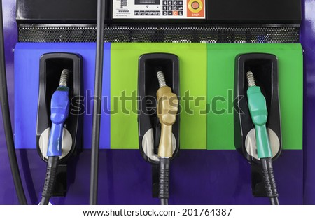line of gasoline pump nozzles - stock photo