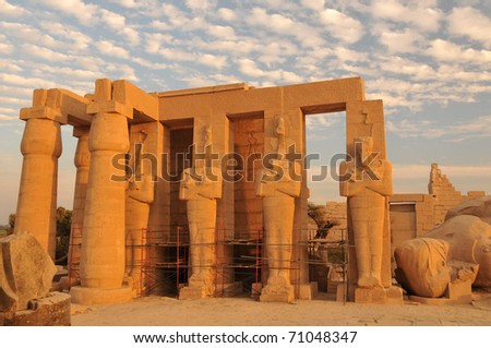 Line of giant Osiris statues at the Ramesseum, the ancient egyptian mortuary temple of Ramses II at thebes near Luxor, Egypt - stock photo