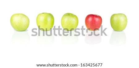 Line of green apples and one red apple isolated on white - stock photo