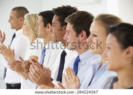 Line Of Happy And Positive Business People Applauding - stock photo