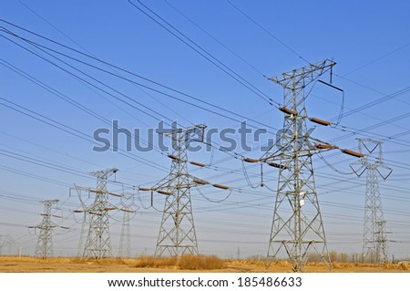 Line of high voltage electrical converter equipment in power plant  - stock photo