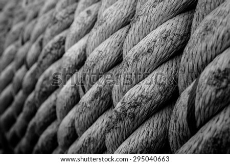 line of rope on boat's deck with soft dark tone. - stock photo