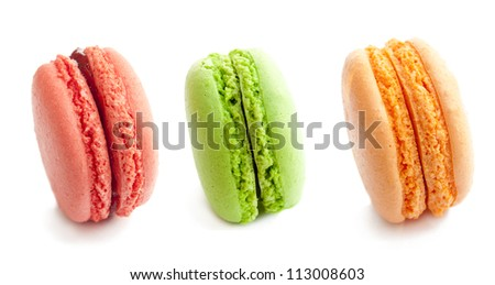 line of three delicious french macaron cookies  isolated on white - stock photo